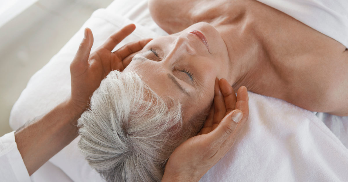 Mature woman getting a facial massage