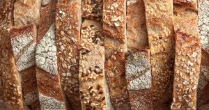 Different pieces of fresh bread with flax seeds and sesame seeds