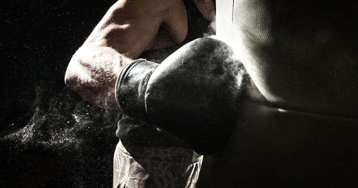 Boxer punching boxing bag