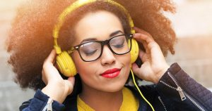 Woman listening to music via wired headphones