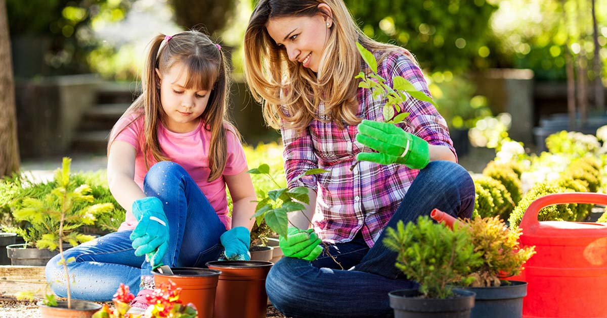 Mother and daughter planting a garden together