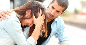 Boyfriend is trying to comfort sad girlfriend