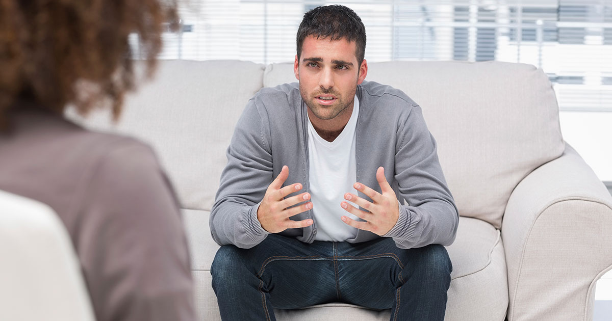 Man talking to his therapist