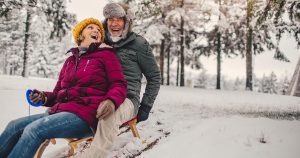 Elderly couple sledding
