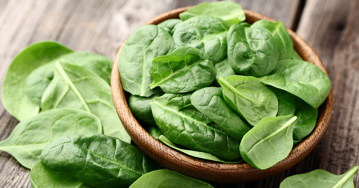 A bowl of spinach leaves: an example of good foods for depression