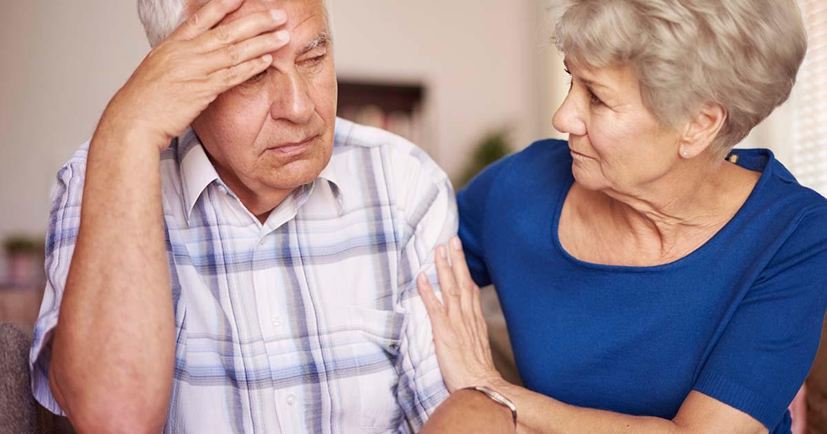 Wife comforting her anxious and sad husband