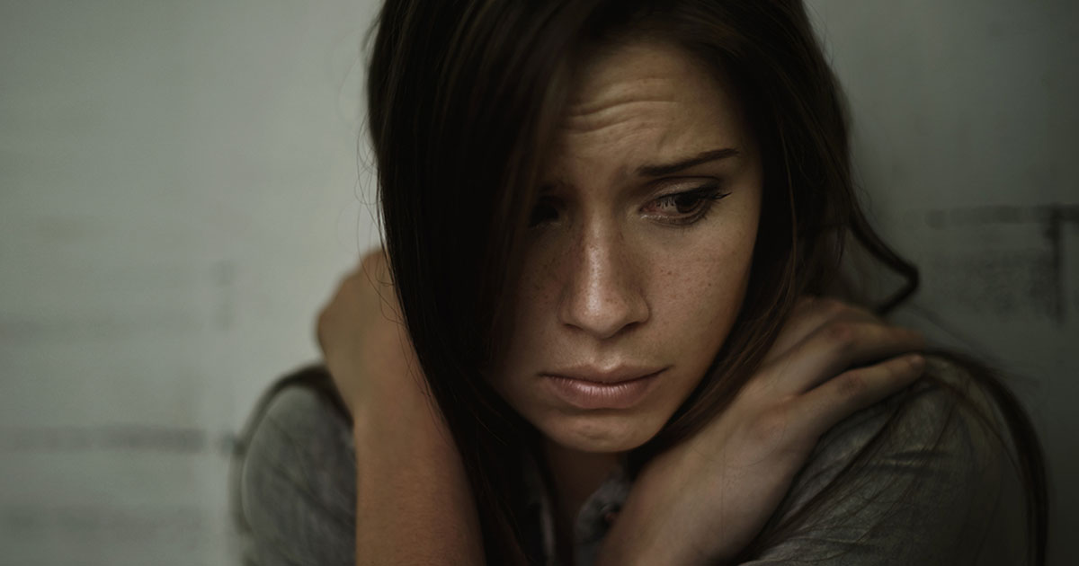 Depressed woman hiding