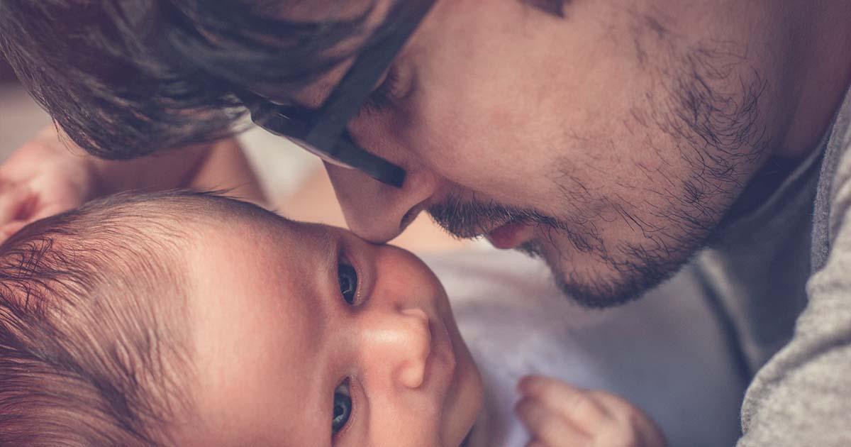 Dad nuzzling his newborn