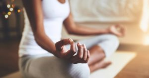 Woman meditating in living room