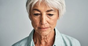 Depressed mature woman looking down