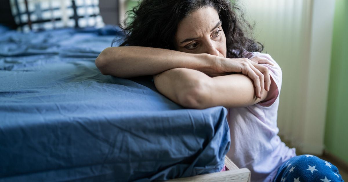 a woman experiencing symptoms of depression including fatigue and loss of motivation