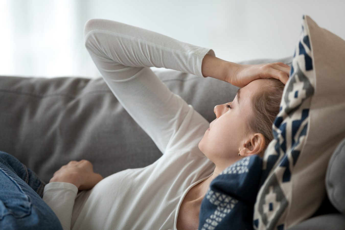 a woman experiencing the fatigue associated with anemia and depression